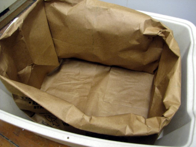 Place paper bag in Litter Box