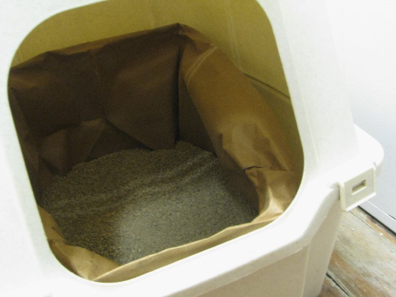 Litter inside paper liner inside covered litter box