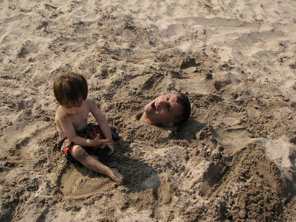Father is buried in the sand